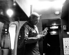 Neil Armstrong playing ukulele