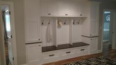 White cabinets and walnut top by Foster Custom Cabinetry