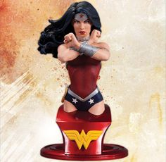 """Wonder Woman - Sculpted by Jim Maddox    Sporting an all-new costume designed for the DC Comics! This expertly crafted bust features Wonder Woman poised for a fight–but don't fight the urge to order this now!    Measuring approximately 6"""" high x 3.5"""" wide x 4"""" deep, this hand-painted, cold-cast porcelain statue is packaged in a 4-color box.    Already a member?  To add this bust to your 'Pull List' use the following link to pre-order your statue:  http://pulllist.comixology.com/sku/JUN120"""