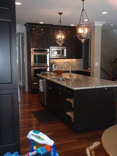 Espresso Cabinets with light granite -- for kitchen remodel kitchens, lights, espresso cabinet, floors, countertops, light fixtures, granite, stainless steel, kitchen cabinets