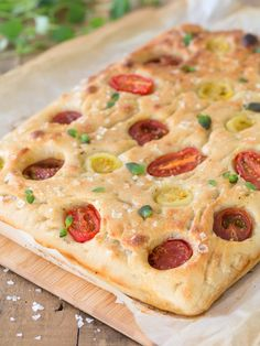Poolish focaccia bread with cherry tomatoes.
