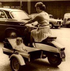 A woman's place is... riding a motorcycle and sidecar.