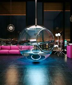 Suspended bath sphere - Filling from the top, it works as either a tub or a shower. Think I would install it in a bedroom.