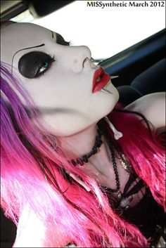 cyber style makeup with pink - violet pastel hair.