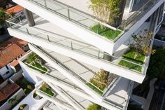 Glass-lined balconies are recessed in some areas and jut outward in others, making them look sloped from a distance. Event Room, Landscape Design Plans, Apartment Floor Plans, Tower Design, Urban Park, Storey Homes, Pent House, Terrace, Architecture Design