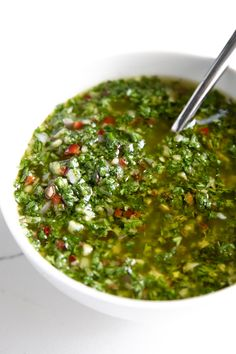White bowl filled with authentic chimichurri sauce. White bowl filled with authentic chimichurri sauce. Steak Recipes, Sauce Recipes, Cooking Recipes, Healthy Recipes, Chimichurri Sauce Recipe, Marinade Sauce, How To Make Chimichurri, Peruvian Recipes, Mexican Food Recipes