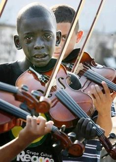 """This is a picture of a brazilian kid who was part of the """"cultural group of reggae"""", playing his instrument in the funeral of his mentor who saved him from an environment of poverty and crime. He was rescued from the street."""