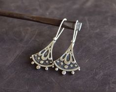 Sterling Silver Tribal and Elegant Earrings, Contemporary Original Floral Design engraved with little circles, Contemporary Jewelry Silver by AlejandraGiannoni on Etsy https://www.etsy.com/listing/182098320/sterling-silver-tribal-and-elegant