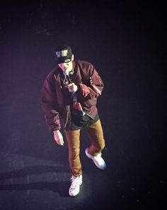 Rapper, Logic, wearing Alpha Industries MA-1 Flight Jacket while performing in NYC.