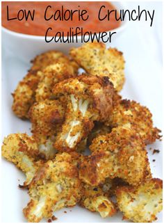 Low Calorie Cauliflower Crunch - This is a crunchy comfort food, made into a diet dish. I kept the calories to a minimum, so there is no cheese and they are baked, not deep fried. Just a little oil, lightly sprayed just before cooking