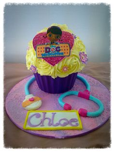 Doc mcstuffins giant cupcake with edible image and fondant stethoscope