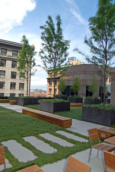Cafe seating, planters and sedum at the 75 State Street green roof in Boston, MA.