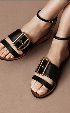 black leather sandals with slim ankle strap and brass buckle
