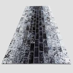 Black & white handmade cowhide Rug with mix of tile sizes