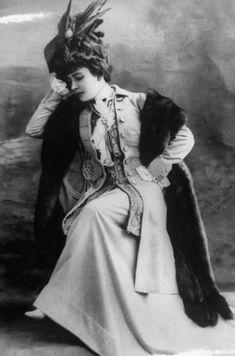 French woman posing for cameo modeling what a lady of fashion would be wearing in the Belle Epoque.