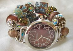This brown and turquoise beaded watch band features chunky beads of brown and turquoise. There are various textures and designs on the beads. These beads are accented in silver and the band is completed with a brown and silver - easy to read - round Narmi watch face.