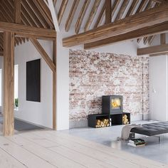 """Rais Q-Tee 3 Wood Stove I love the minimalist lines and function of this stove. Big US sized firebox allows 16"""" logs. Matching wood cubbies can be arranged to fit your space."""