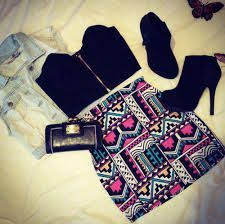 tribal pattern high high waisted skirt, denim jacket, black ankle boots and a cropped boob tube for clubbing