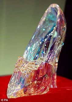 The Swarovski glass slippers worn by Lily James in Cinderella (left) were designed by Sand...
