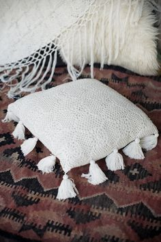 Gorgeous simple tasseled crochet cushion case - a gorgeous cushion for any room decorated in creamy/white/beige/earthy tones, and because it's so neutral it also works with brights. Measurements: Length 48 cm | Width 46 cm Please note: Cushion insert is not included.