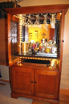 DIY converted a TV hutch into a lit up liquor cabinet ...
