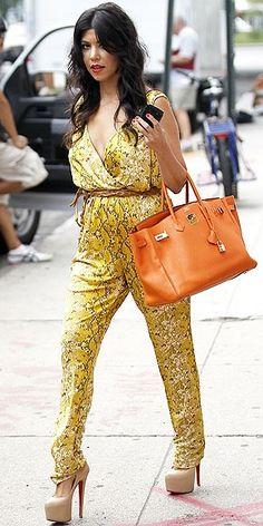6aba213a307 Who made Kourtney Kardashian s orange handbag