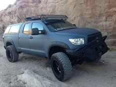A Toyota Tundra painted with LINE-X, a spray-on protective coating, maneuvers during a photo shoot in the desert.