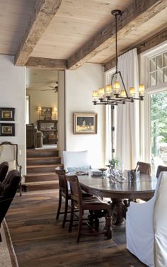 Residence, dining. Our reclaimed antique white oak flooring and beams #wholeloglumber. #rustic