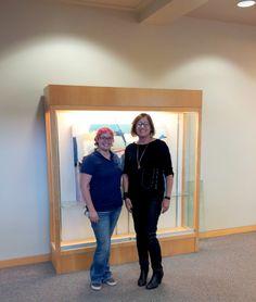 Gallary Preparator Michelle Hauswirth installs Danielle Nelisse's art exhibit at the Dove Library in Carlsbad, California   art and climate change exhibit   www.daniellenelisse.com   #art #abstract #contemporary   2015