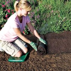 Hmmmm . . . recycled rubber mulch carpet prevents weeds, looks like mulch without the mess.