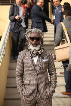 A man always expresses his own style, but doing it with class  carrying it out with dignity makes him a gentleman. scarf  suit