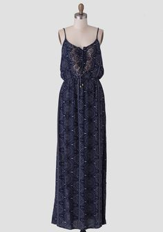 A Ruchette must-have, this navy blue maxi dress is rendered in a soft gauzy fabric with a gray-hued global-inspired print allover. Perfected with lace-up detailing at the bust accented with bronz...