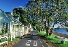 Russell, Bay of Islands, New Zealand - this one way road is magical in summer when the pohutukawa trees are in flower, along with views out across the bay, & alongside the very famous Duke of Marlborough Hotel.