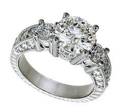 A stunning three stone vintage engagement ring.     http://www.kooroshandvalencia.com/antique-3-stone-round-diamond-engagement-ring-pave-set-rings.aspx