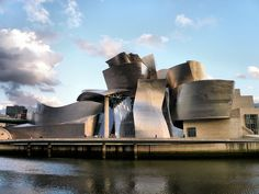 The Guggenheim Museum Bilbao (opened in 1997) is a museum of modern and contemporary art, designed by Canadian-American architect __ FRANK GEHRY