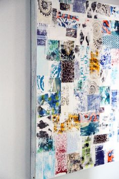a painting covered in fabric scraps...a quilt with no sewing...this is genius!