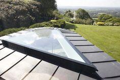 Shaped frameless glass rooflight set within a standing seam aluminium roof