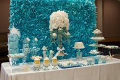 "This #mermaid themed #party table is stunning with high impact from a ""seaweed"" wall and tasty treats. #desserttable"
