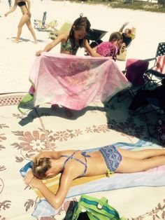 Chilling in the sun at destin Florida beach getting a tan!