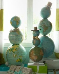 globe snow men and snow women, such a cute idea for school room!