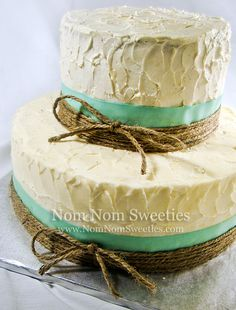 Rustic Wedding Cake - A rustic style wedding cake with messy buttercream, teal cosgrain ribbon and twine bows.