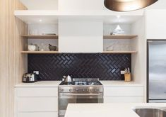 The Sophisticated New Tile Trend We Can't Get Enough OfSubway tiles needn't be white and horizontal; here, matte black tile is arranged in a zigzag, with black grout keeping the backsplash from looking too busy. Black Splashback, Kitchen Splashback Tiles, Kitchen Soffit, Kitchen Black Tiles, Modern Kitchen Backsplash, Rustic Backsplash, Kitchen White, Kitchen Flooring, Backsplash Herringbone