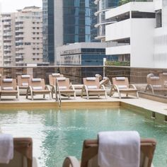 Spend an afternoon by Waldorf Astoria Panama's rooftop pool for ultimate relaxation.
