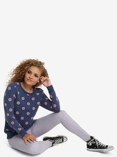 You and the Captain will be making warmth happen every time you wear this sweatshirt. The faded pullover looks like your most loved article of clothing and has an allover Captain America shield print. Be patriotic, fashionable, warm, and show off your fandom all at the same time.     Officially licensed by Her Universe  80% cotton; 20% polyester  Wash cold; dry low  Model is wearing size small  Imported  Listed in junior sizes