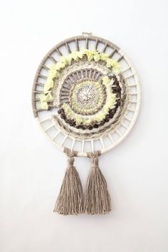 Woven Wall hanging, circular wall art, dreamcatcher by HandPlusFiber on Etsy   This circular wall hanging was woven on an embroidery hoop using different hand dyed fabrics and yarn. embellished with a mosaic mirror in the middle.
