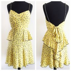 """Anna Sui Adorable Yellow Geometric Prnt Silk Dress Adorable yellow silk dress from Anna Sui features fun geometric print, ruching at bust, peplum at waist, beaded straps, bow tie and ruffle detail in back and flare skirt. Back zip. Fully lined. It has a fun, retro vibe.   • size 4 • 34"""" bust 