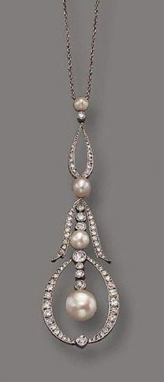PLATINUM, DIAMOND AND PEARL LAVALIERE, CIRCA 1910