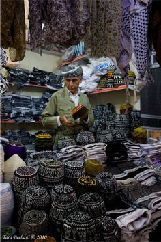 Inside the Kurdish old bazar known as Qaisari. Kurdish hat and Jamadani (Kudish turban) store. Erbil, Iraqi-Kurdistan.