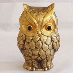 1964 was a GREAT year! This little guy can tell you all about it - wonderful vintage table lighter in glorious gold with Jet Crystal Eyes!