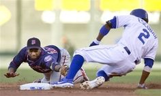 Minnesota Twins second baseman Alexi Casilla (12) dives to try and tag Kansas City Royals' Alcides Escobar (2) during the first inning of a baseball game at Kauffman Stadium in Kansas City, Mo., Friday, July 20, 2012